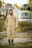 Young pilot posing near the helicopter Stock Image