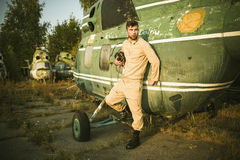 Young pilot posing near the helicopter Stock Photography