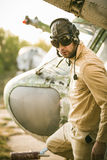 Young pilot posing near the helicopter Royalty Free Stock Image