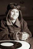 Young Pilot smiling at camera. A confident young pilot in flight jacket / hat / goggles is smiling at the camera Royalty Free Stock Photos
