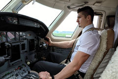 Young pilot starting engines Royalty Free Stock Photo