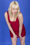 Young Pin Up Model Posing in Red Short Dress Stock Images