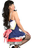 Young Pin Up Model Wearing Sexy Naughty Sailors Costume with Black Fish Net Stockings Royalty Free Stock Photos