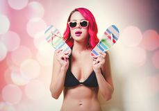 Young pink hair girl in bikini and orange glasses stock photos