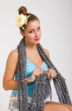 Young pinup woman knitting a scarf Royalty Free Stock Photos