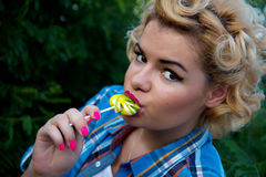 Young pinup woman with lollipop Stock Photo