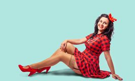 Young Pinup Woman Sitting On The Floor Royalty Free Stock Photography