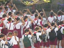 Young Pioneers Salute. Cuban School Children (Young Pioneers) salute the Cuban flag Stock Image