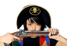 Young pirate. Woman in pirate costume with ancient pistol in hands Royalty Free Stock Images