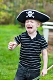 Young pirate crying. Young boy wearing pirate hat crying Stock Images