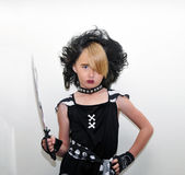 Young pirate girl and sword Stock Photos