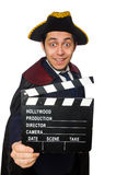 Young pirate holding clapperboard isolated on Stock Image