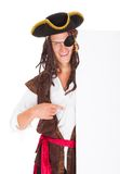 Young Pirate Pointing At Blank Placard Stock Photos