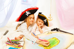 Young pirates drawing the treasure map Royalty Free Stock Photos