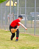 Young Pitcher Warming Up. A young baseball player warming up before the game. 10 years old royalty free stock image