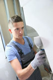 Young plasterer in apprenticeship at work stock image