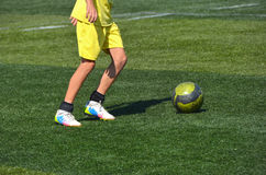 Young player with ball. In yellow dress Stock Image