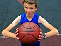 Young player with a basketball on the court Royalty Free Stock Image