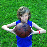 Young player with a basketball outdoors Stock Photography
