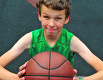 Young player with a basketball Royalty Free Stock Images