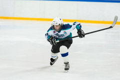 Young player on the ice Royalty Free Stock Image