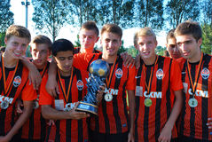 Young players with medals and cup Royalty Free Stock Photo