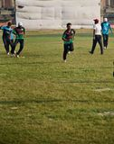 Young boys running in a field. Young players are running around a sports ground unique editorial photo stock photos