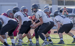 American high school football game. Young players taking part in an American high school football game Royalty Free Stock Photo