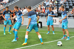 Young players team Zenit playing with a ball in the corner of the field Royalty Free Stock Photo