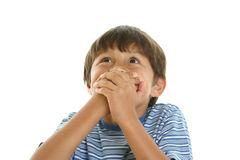 Young playful boy covering mouth Stock Images