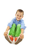 A young playful boy sitting on the floor Royalty Free Stock Photography
