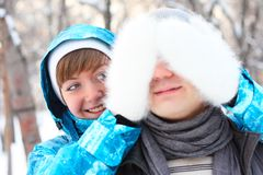 Young playful couple has a fun. Winter Royalty Free Stock Photos