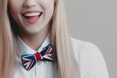 Young playful cute blonde with bow tie is laughing stock photos