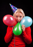 Young playful happy girl with balloons. Portrait of attractive playful  blonde with balloons Royalty Free Stock Images