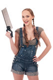 Young playful woman holding hand saw Royalty Free Stock Photography