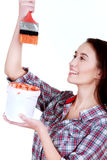 Young playful woman in shirt and jeans  painting Royalty Free Stock Photos