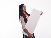 Young playful woman showing presentation, pointing on placard Stock Photos