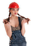 Young playful worker woman in coverall and helmet Stock Photo