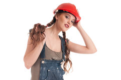 Young playful worker woman in coverall and helmet Stock Image