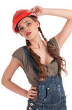 Young playful worker woman in coverall and helmet Royalty Free Stock Photos