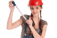 Young playful worker woman holding tape measure Royalty Free Stock Image