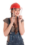 Young playful worker woman holding tape measure Royalty Free Stock Photography