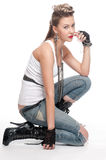 Young playfull rock girl on white Royalty Free Stock Photo