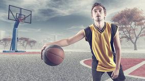 Young playing basketball royalty free stock photo
