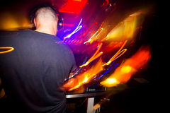 Young plays DJ  playing a popular mix in fashionable clubs Stock Photos