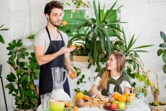 Young pleasant bearded man is juggling with mandarins stock photo
