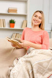 Young pleasant woman reading a book Royalty Free Stock Image