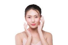 Young pleased woman with natural makeup touching her face Royalty Free Stock Photography