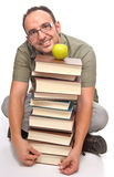 Young with plenty of books with a green apple Royalty Free Stock Image