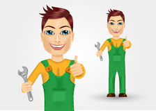 Young plumber dressed in green work clothes Stock Images